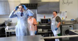 Minister for Health Simon Harris with kitchen staff Tracy Bailey and Sandra Wynne at the National Council for the Blind of Ireland's Iona Resource Centre in Dublin on Wednesday. Photograph: Dara Mac Dónaill