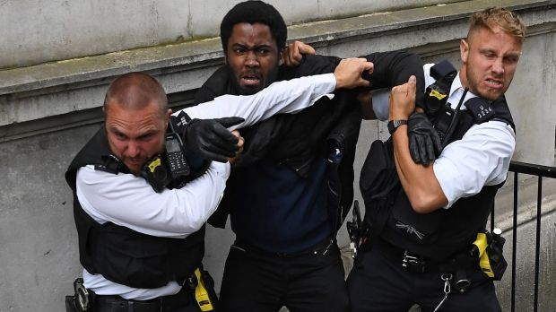 Irish backstop - Police officers detain a protestor near the entrance to Downing Street, during an anti-racism demonstration in London. Photograph: Daniel Leal-Olivas/AFP via Getty Images