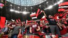 Budapest Honved fans sing ahead of the Hungarian Cup Final against Mezokovesd Zsory FC in the Puskas Ferenc Arena in Budapest. Photo: Zsolt Szigetvary/EPA