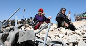 Palestinians collect their belongings after Israeli forces demolished their house in the occupied West Bank city of Yatta, claiming it was built without permision. Photograph: Abed al Hashlamoun/EPA