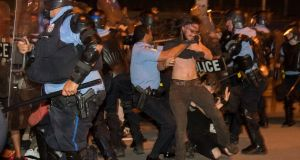 Police in New Orleans  clash with protesters on Wednesday night. Photograph: Chris Granger/The Advocate via AP