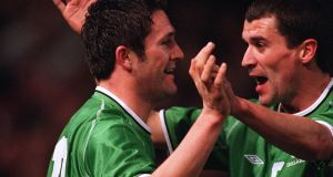 Robbie and Roy Keane celebrate a goal for Ireland in 2002. Photograph: Inpho