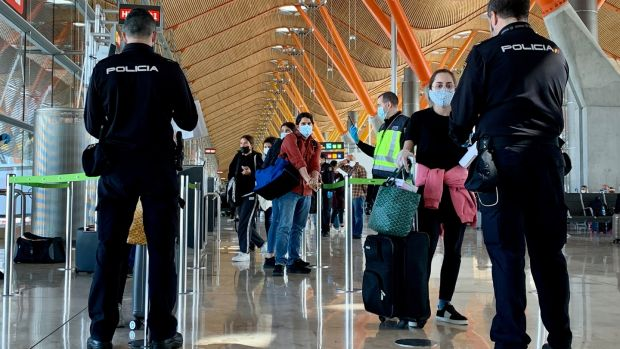 Spanish police officers check on passengers upon their arrival from Paris on May 16th at the Madrid-Barajas Adolfo Suarez airport in Barajas. Photograph: Gabriel Bouys/AFP via Getty Images