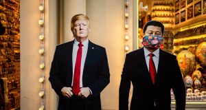 Cardboard figures of US president Donald Trump and Chinese president Xi Jinping   outside  a souvenir shop in downtown Moscow on June 3rd, 2020. Photograph:  Dimitar Dilkoff/AFP via Getty Images