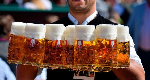 Beer makers from global giant Anheuser-Busch InBev to smaller craft brewers have set up schemes for consumers to buy drinks in advance to support shuttered bars. Photograph: AFP via Getty