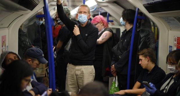 Some passengers wear face masks on a London underground train on Wednesday. Face coverings will be compulsory on public transport in England from June 15th. Photograph: Tolga Akmen/AFP via Getty