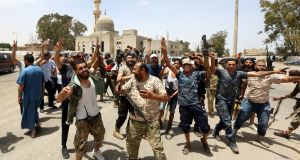 Fighters loyal to the UN-recognised Libyan government of national accord (GNA) celebrate in the Qasr bin Ghashir district south of Tripoli on Thursday. Photograph: Mahmud Turkia/AFP via Getty Images