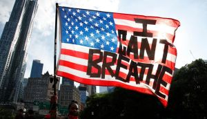 I can't breathe: a protester in Manhattan. Photograph: Jason Szenes/EPA