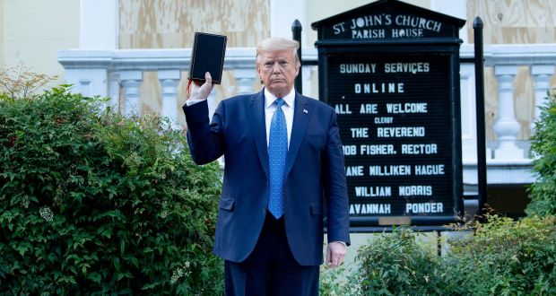 Donald Trump outside St John's Episcopal Church. Photograph: Brendan Smialowski/AFP via Getty
