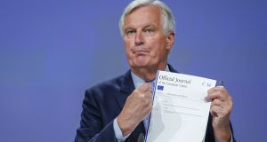Michel Barnier holds the Official Journal of the European Union C34 during a press conference on Friday in Brussels regarding the fourth round of Brexit negotiations. Photograph:  Daina Le Lardic/ Pool/Getty Images