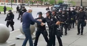 In this image from video provided by radio station WBFO, a police officer appears to shove a man who walked up to police in Buffalo, New York. Video shows the man appearing to hit his head on the pavement. Photograph: Mike Desmond/WBFO via AP