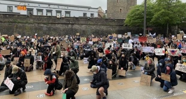 Protesters in Derry's Guildhall Square showing solidarity with the Black Lives Matter movement in the US. Photograph: Freya McClements