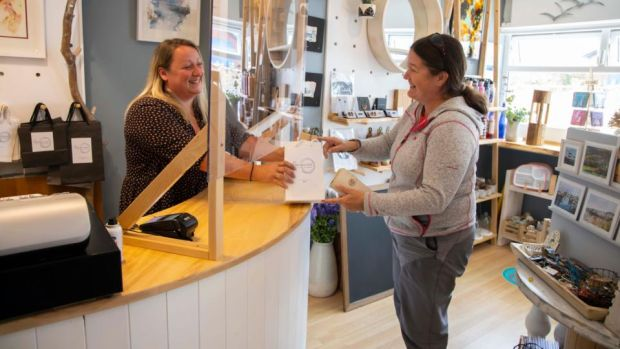 "Emma Loftus, owner of Breakwater Gift Shop, with customer Aine Knox: ""You can't run a business with your heart. It has to be with your head."" Photograph: Patrick Browne"