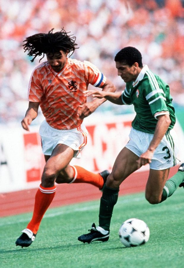 The Republic of Ireland's Chris Hughton chase Holland's Ruud Gullit during the European Championships in 1988. File photograph: Billy Stickland/Inpho