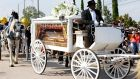 The casket carrying the remains of George Floyd arrives by horse-drawn carriage at Houston Memorial Gardens for his funeral in Pearland, Texas. Photograph: Aaron M Sprecher/EPA