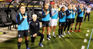 Megan Rapinoe takes the knee during the national anthem ahead of a game against Thailand in September 2016. Photograph: Jamie Sabau/Getty