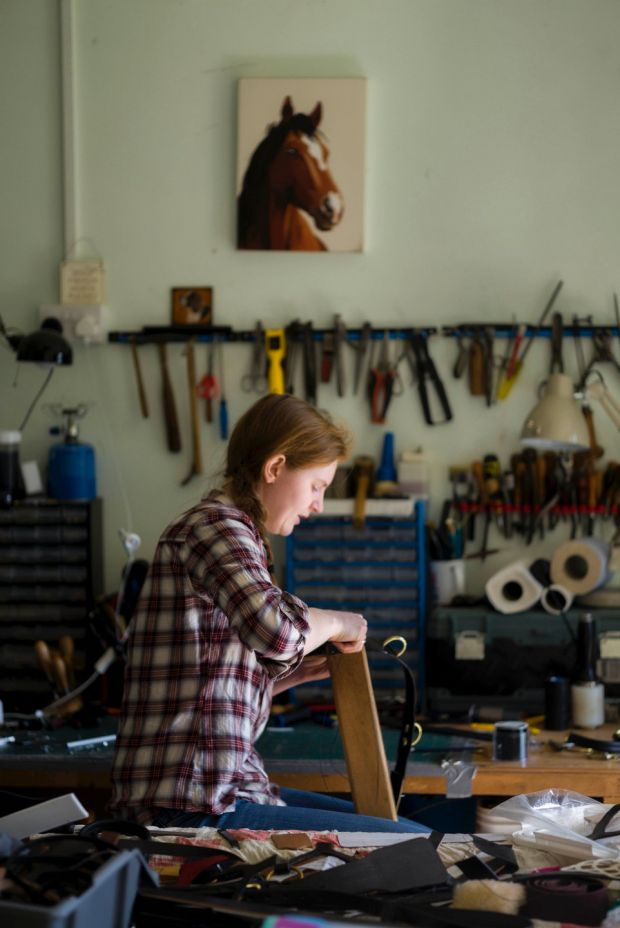 Saddle maker Lucy Cushley in her workroom in Co Down