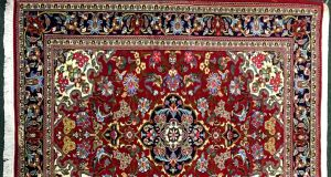 A Persian Qom rug which once hung on the walls of a home in Abbasabad, and part of the collection of Dr Harry Blake will be auctioned online tomorrow June 14th by Hegarty's in Bandon ( 600- 800)