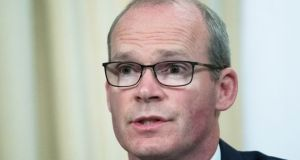 The wife of the Irish businessman who is barred from  leaving China   met with Minister for Foreign Affairs Simon Coveney but says she has had no further feedback since the initial meeting. Photograph:     Pavel Golovkin/AP
