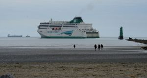 An Irish Ferries ship leaving Dublin as seen from Dollymount beach. Photograph: Alan Betson