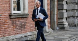 Tánaiste Simon Coveney: told a Fine Gael parliamentary party meeting some 'heavy lifting' still needed to be done in the talks. Photograph: Leon Farrell/Photocall Ireland