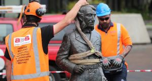 Workers remove a controversial statue of  Charles Hamilton from Civic Square in Hamilton on Friday. Photograph: Michael Bradley/AFP/Getty Images