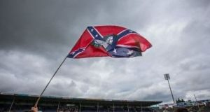 A Confederate flag held by a Cork supporter after the hurling All-Ireland quarter-final in 2015. Photograph: Cathal Noonan/INPHO