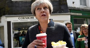 Then  prime minister Theresa May having some chips in one of Cornwall's chi-chi towns during the Brexit campaign. Photograph: Dylan Martinez/PA