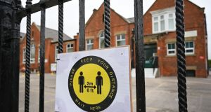 A sign at a school in the UK ask parents and carers of schoolchildren to adhere to the British government's social distancing guidelines. Photograph: Oli Scarff/ AFP