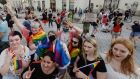 People take part in a rainbow disco flashmob in front of the Presidential Palace in Warsaw, Poland, amid attacks on the LGBT community by president Andrzej Duda. Photograph: AP Photo/Czarek Sokolowski