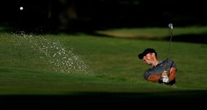 Rory McIlroy  plays a shot from a bunker on the 11th hole during the second round of the Charles Schwab Challenge  at Colonial Country Club in Fort Worth, Texas. Photograph: Tom Pennington/Getty Images