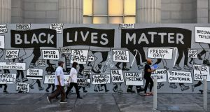 People walk past a 'Black Lives Matter' mural at Union Square in New York City. Photograph: Angela Weiss/AFP via Getty Images