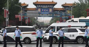 Chinese police guard the entrance to the closed Xinfadi market in Beijing on June 13th, 2020. Photograph: Greg Baker/AFP via Getty Images