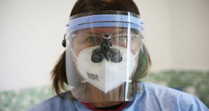 Dentist Caroline Robins of Kiwi Dental, Carlow, in her PPE gear. Photograph: Laura Hutton