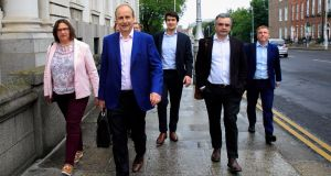 Fianna Fáil leader Micheál Martin and his team arrive at Government Buildings.Photograph: Gareth Chaney/Collins