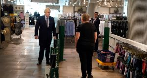 British prime minister Boris Johnson during a visit on Sunday to a London shopping centre before it reopens to the public on Monday. Photograph:  Andrew Parsons/EPA