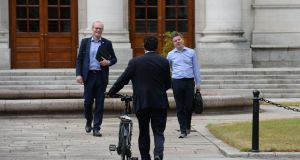 Tánaiste Simon Coveney, Minister for Finance Paschal Donohoe and Green Party leader Eamon Ryan meet for talks on Government formation at Government Buildings. Photograph: Alan Betson / The Irish Times.