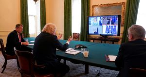 Boris Johnson, David Frost and Michael Gove take part in a videoconference call with the three EU presidents. Photograph: Andrew Parsons/No 10 Downing street