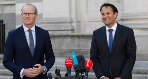 Taoiseach and Fine Gael leader Leo Varadkar (right) and Tánaiste Simon Coveney speaking to the media at Government Buildings in  Dublin on Monday. Photograph: Leon Farrell/Photocall Ireland/PA Wire.