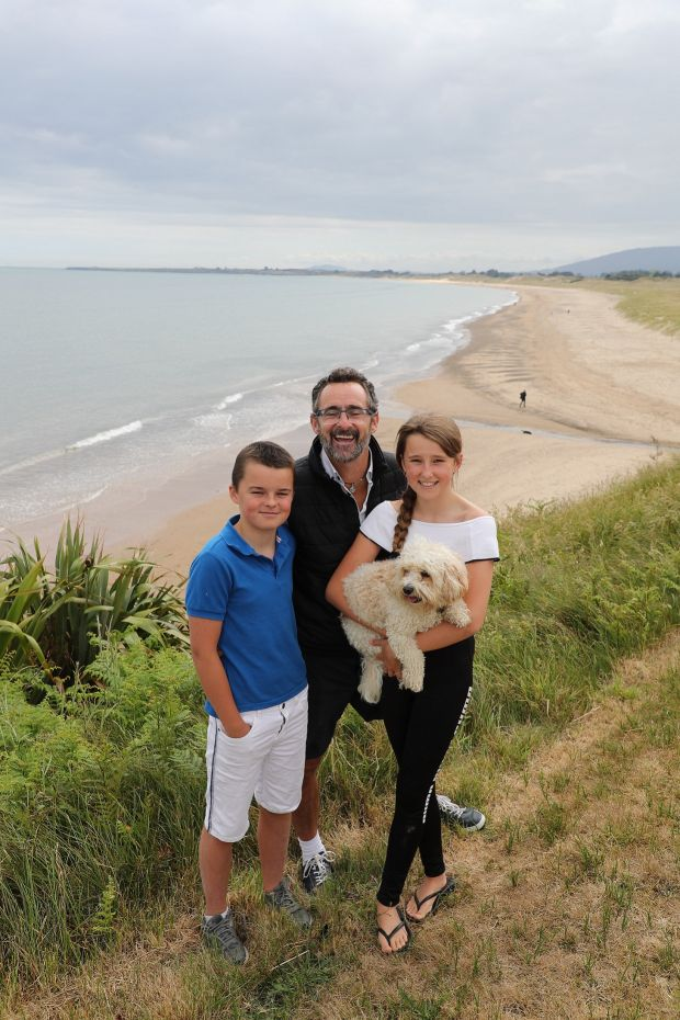 Benji Bennett (centre) with two of his three children Robbie (13) and Molly (12), with family pet Bailey at Potter's Point, Brittas Bay, Co Wicklow. Photograph: Nick Bradshaw/The Irish Times