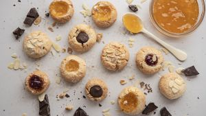 Almond cookies with apricot jam and chocolate.