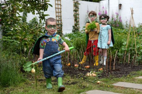BIA-HEROES: Tom (3), Nora (5) and Frank Kenny (7) from Cabra, at the launch of the National BiaHero campaign, which aims to raise awareness of food security and encourage local food systems. Photograph: Dara Mac Dónaill/The Irish Times