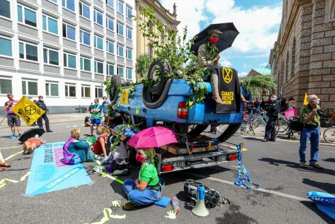 CARS FOR CLIMATE: Extinction Rebellion activists demonstrate outside the headquarters of an industry body for German automotive companies in Berlin, Germany. About 100 people occupied the building's entrance and the junction next to it. Photograph: Omer Messinger/EPA