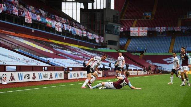 Empty stands greeted the players at Villa Park. Photo: Shaun Botteril/Getty Images