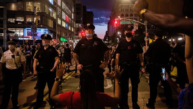 Police and protesters in New York. Photograph:Gabriela Bhaskar/The New York Times