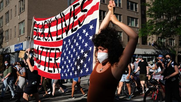 Protesters march through Manhattan in New York City this week. Photograph: Spencer Platt/Getty Images
