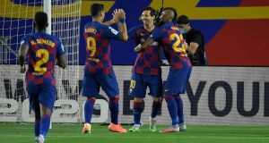 Lionel Messi celebrates with his Barcelona teammates after after the Catalans beat CD Leganes on Tuesday. Photograph: Getty Images