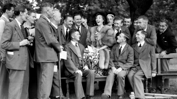 Vera Lynn with ex-servicemen during a garden party held by Queen Elizabeth at Buckingham Palace, in 1950. File photograph: PA/PA Wire