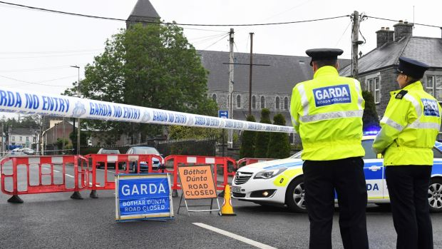 Gardaí at the scene of the fatal shooting of a detective in Castlerea on Thursday. Photograph: Michael McCormack