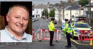 The scene of the shooting in Castlerea was sealed off on Thursday. Photograph: Collins. Insert photograph: Detective Garda Colm Horkan who was killed in the shooting.